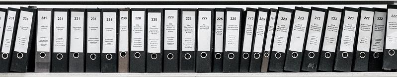 shelf of binders